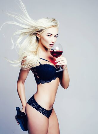 Blonde girl strippers and drink wine. Wine festival concept. Its for man. Gender roles. Private dance inside the club. Striptease is private dancing.