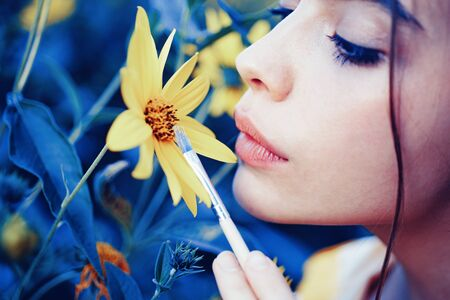 Sensual woman lips. Nature girl concept. Spring painting. Yellow spring mood. Spring lipstick