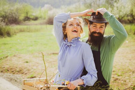 Wife and husband spend time in the orchard. Homegrown organic food. Farmers couple working in field. Couple Farmers.