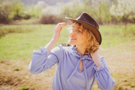 Female Farmer. Happy blonde woman in a green field smiling. Portrait of female farmer in the vegetable garden