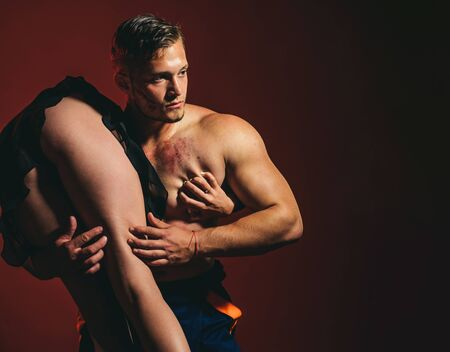 Sexy couple play in love games. Brave firefighter. Saved woman. Dominating in the foreplay sexual role play. Hot Firefighter. Risky occupations concept. Passionate couple concept. 스톡 콘텐츠