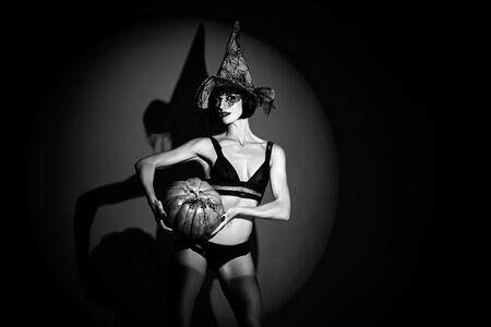 Sexy stripper Woman with pumpkins. vampire girls. Sunsual desire concept. Halloween lingerie model. Zdjęcie Seryjne