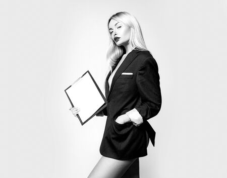 This stylish clip board keeps all documents handy. Sexy business woman holding clip board. Sensual manager with writing board for document management. Clip board solution, copy space