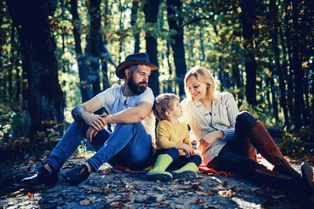 Autumn Family Camping in the Park. Active people and happy family concept. Outdoors. Autumn camping with kids, mom and father. Stok Fotoğraf