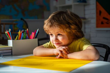 Cute face of pupil, close up. Portrait of Pupil of primary school study indoors. Learning and education concept. Stock Photo