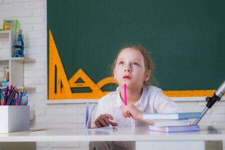 School kids. Cute pupil schooling work. Happy school kids at lesson.