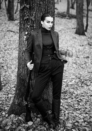 woman with weapon. Target shot. female hunter in forest. girl with rifle. chase hunting. Gun shop. successful hunt. hunting sport. military fashion. achievements of goals. Masculine hobby activity Reklamní fotografie