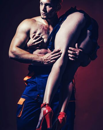 Passion. Sexy muscular rescuer men with fragile woman. We need to live with passion. Passionate couple concept. Long leg on muscular rescuer men. So passionate couple.