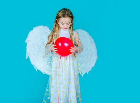 Kids Valentines Day. Cute child girl posing with angel wings. Child angel with a beautiful wings. Saint Valentines Day card. Looks like an angel.