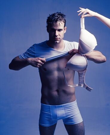 He is fan of really huge size. Big body parts. Female lingerie concept. Guy love big breasts. Fashion accessory. Handsome attractive man fond of boobs. Man with big bra underwear