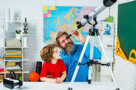 Intelligent, smart ass kids. Games good for brain intelligence concept. Young kid boy playing with Astronomy telescope.