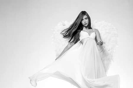 Angel wings. Young woman in angel costume. Valentines day and costumes concept. Cupid woman. Valentines Day concept. Stock fotó