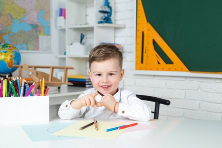Pupil education concept. Cute pupil with funny face schooling work. Home schooling.