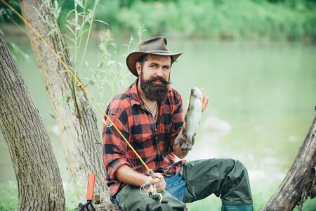 Elegant bearded man fishing. Fish on hook. Carry on fishing. Man catching fish. Happy bearded fisher in water. Man bearded fisherman. Relax on nature. It is not sport it is obsession.