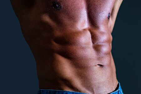 Closeup of cool perfect sexy strong sensual bare torso with abs pectorals and 6 pack muscles and muscular chest black and white studio. Men abs. Fitness abdominal muscle. Man six pack. Stock Photo