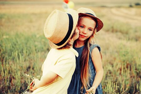 Child playing Happy childhood. Love concept. Romantic and love. Sweet angel children. Kid having fun in spring field. Valentines day card.