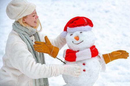 Winter girl Having Fun in Winter Park. Women in winter clothes. Winter portrait of young beautiful woman in snow Garden.