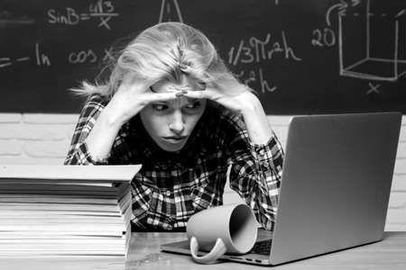 Back to school. Girl stressed by studying to hard screaming classroom background. Studying at university. Teachers day. Bad exam.
