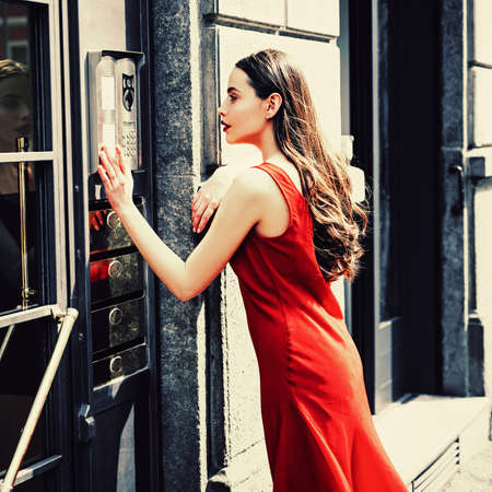Young woman posing. Portrait of serious woman. Sensual model girl with smooth skin in a summer dress. Sensual woman. Full length portrait happy fashion woman walking in town. Banque d'images