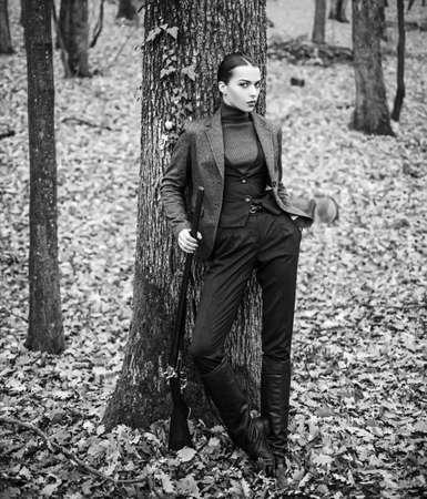 Woman Hunter. Hunting season. Hunter hunting. Hunting in autumn forest.