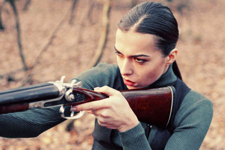 hunter carry rifle. Target shot. female hunter in forest. woman with weapon. successful hunt. hunting sport. girl with rifle. chase hunting. Gun shop. military fashion. achievements of goals