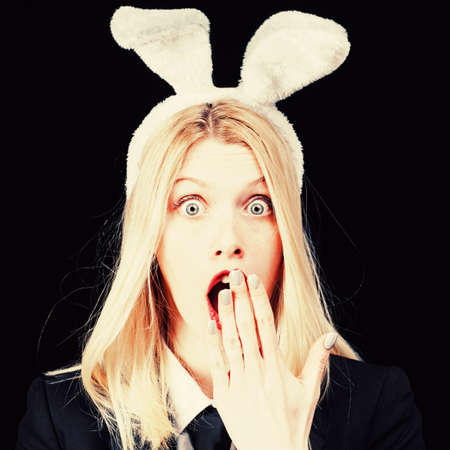 model dressed in costume Easter bunny. Woman rabbit easter bunny girl. Fashion studio photo of beautiful girl with blond hair with bunny ears. Surprise.