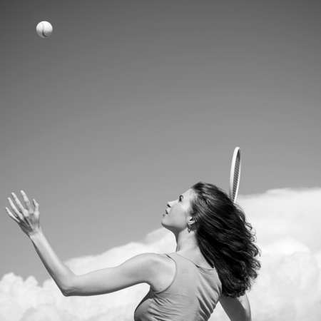 Improving her tennis game. athletic woman playing tennis game outdoor. Fit tennis player hitting a shot during the game. Sensual girl as good as her sport game Banque d'images