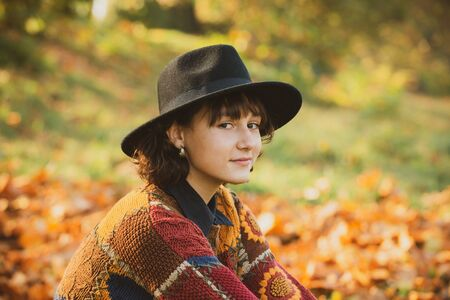 Autumn day. Autumn outdoor portrait of beautiful girl walking in park or forest. Outdoor. Фото со стока