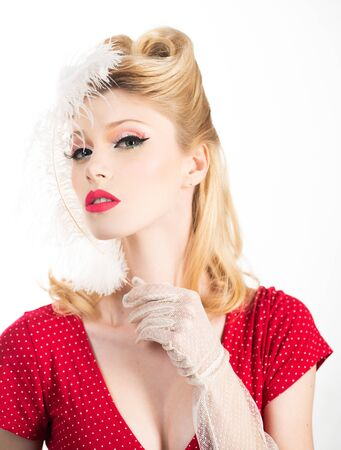 Portrait of beautiful young woman with vintage make-up and hairstyle. Pin-up girl. American style.