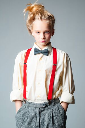 teen girl in retro male suit. retro fashion model. vintage charleston party. jazz step fashion. suspender and bow tie. old fashioned child. vintage english style. Open and sociable Banque d'images