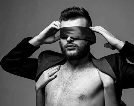 Blindfolded. Woman covering man eyes. girl closes eyes of a man.
