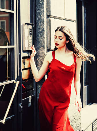 Youth fashion. Portrait of beauty model girl. Stunning face. Urban view. Young cheerful fashionable woman during walking on street. Female fashion beauty and advertisement concept. Stockfoto