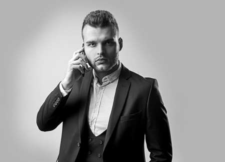 Man in suit using smart phone. Business man in work with phone mobil. Luxury classic suits, vogue. Man fashion. Meeting phone. Main responsibility. Useful nowadays. Discussing the current project