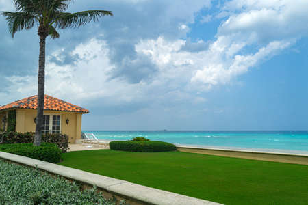 Beach lounge, sun loungers with private swimming pool with panoramic sea view at villa.