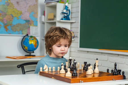 Chess, success and winning. Preschooler or schoolboy, Kids early development. Intelligent, smart kids. Games good for brain intelligence concept.