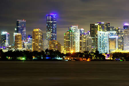 Miami business district, lights and reflections of the city lights. Miami night downtown, city Florida.