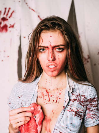 A terrible Halloween. Horror girl. Full of blood. Aggressive girl in blood. Donation and donar. Blood on face. Animal hunger. Bloody mess. Blood lust. Crazy.