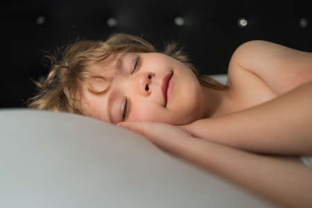 Smiling kids sleeping in bed. Sweet dreams. White pillow. Little angel dreams.