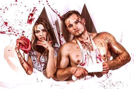 Terrifying zombie couple. Family profession. Bloody mess. Wild people. Stok Fotoğraf