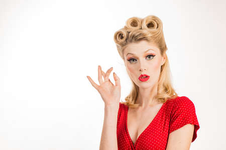 Beauty Woman face Portrait. Beautiful girl pointing fingers away at copy space.