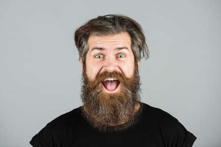 Happy man smile face. Handsome smiling young guy with long beard and moustache. Bearded man. Positive human facial expressions and emotions.