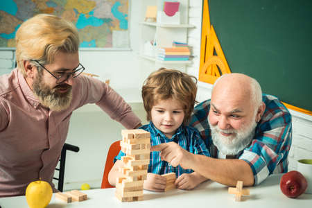 Male generations friendship. Happy little child father and grandparent leisure fun time. Grangfather, Father and son playing game at home.