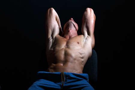 Bare torso of a muscular man. Sexy gay.