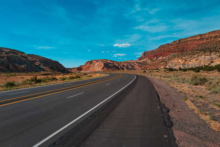 Road trip in Arizona desert. Background of road and sky.