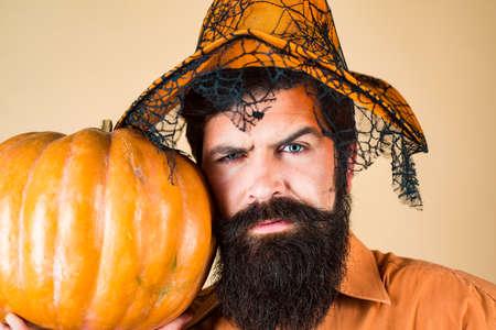 Happy Halloween Stickers. Smiling happy man with pumpkin. Halloween Man posing with pumpkins. Thanksgiving seasonal cooking ingredients.