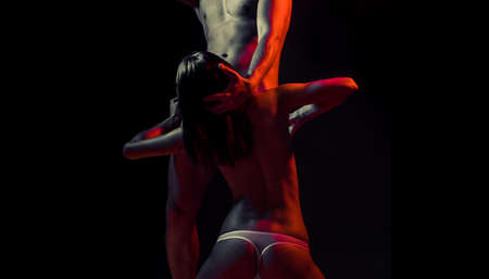 Undressed couple in love hugging passionately. Sexy seduction. Naked body, torso. Romantic tender. Erotic people concept.