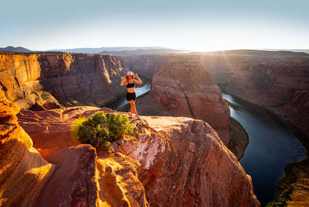 American tourist. Arizona Horseshoe Bend of Colorado River in Grand Canyon. Travel and adventure concept.
