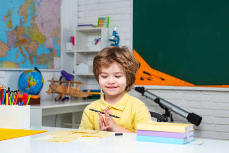Home schooling. Child home studying and home education. Pupil learning letters and numbers. Chalkboard copy space.