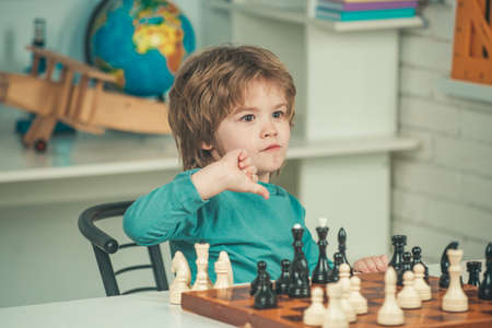 Thinking child. Intelligent, smart kids. Games good for brain intelligence concept. Kid Playing Chess