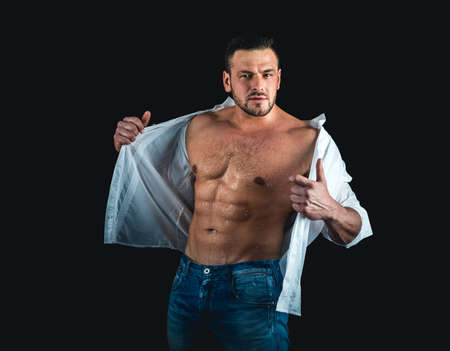 Muscular man with torso. Sexy muscular gay. Muscular man showing his chest during striptease.